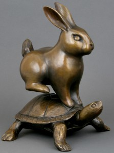 A bronze statue of the tortoise and the hare in our office at Crown Hill Smiles in Seattle, WA