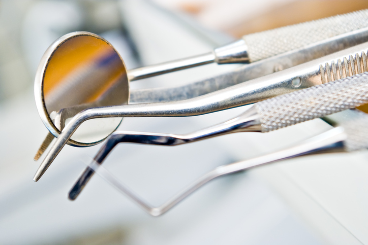 Close up of dental cleaning and exam tools from Crown Hill Smiles